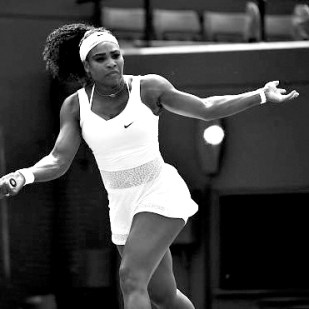 Serena Williams going in for the kill in a tiger patterned translucent midriff dress by Nike Court
