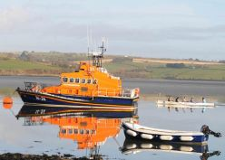 Courtmacsherry rowers reflect in the early morning sunshine as they are about to pass the Courtmacsherry Lifeboat. Picture: Martin Walsh.