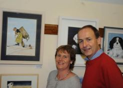 Minister for Foreign Affairs, Micheal Martin and his wife, Mary, viewed the art exhibition at the Courtmacsherry Harbour Festival. Photo: Martin Walsh.