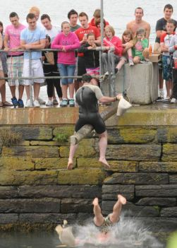 A competitor makes a splash during the Pillow Fight at the Courtmacsherry Regatta. Picture: Martin Walsh.