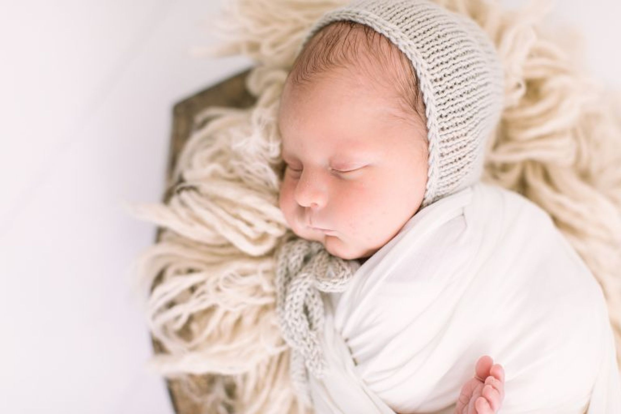 Posed newborn photo in studio with Courtney Griffin Photography   Houston, Texas