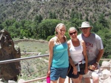courtney next to mom and dad on a hike