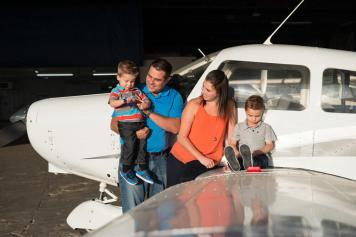 Favel Family on a plane at the Regina Flying Club - Favel Family 2015