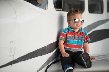 Jace with aviators on a plane at the Regina Flying Club - Favel Family 2015