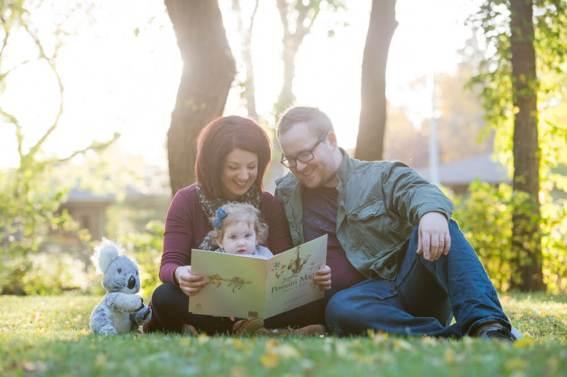 Regina Family photography session with Courtney Liske Photography - reading Possum Magic in Wascana Park
