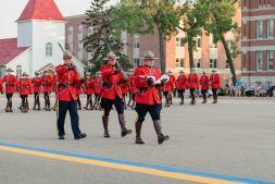 Courtney Liske Photography - Regina Family Photographer - RCMP - Sunset-Retreat Ceremony - Flag