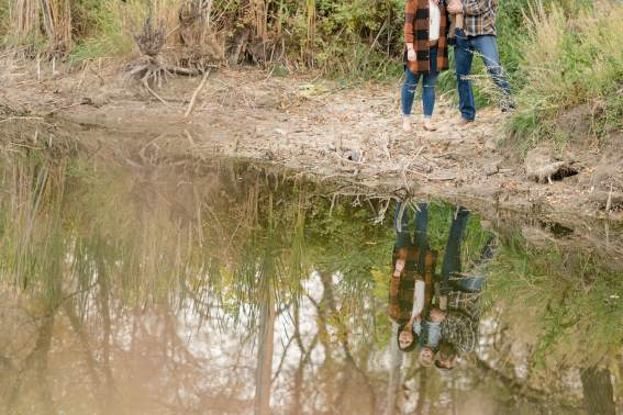 Family reflection in still water
