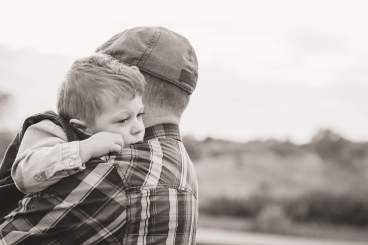 Little boy over his fathers shoulder
