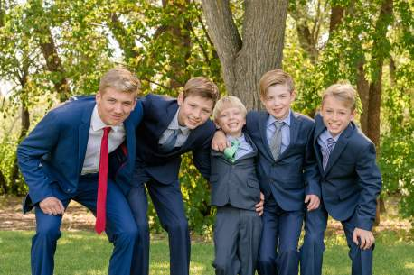 Boy cousins dressed in suits