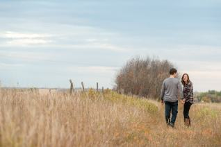 Couple walking as woman looks back laughing