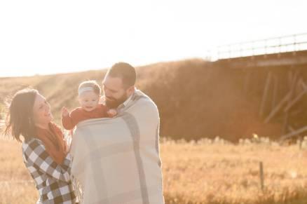 Family cuddling in the warm morning sunlight