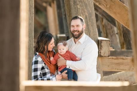Family under a wooden bridge near White City