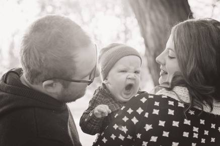 Little boy yawns with mom and dad on a walk in Regina Saskatchewan