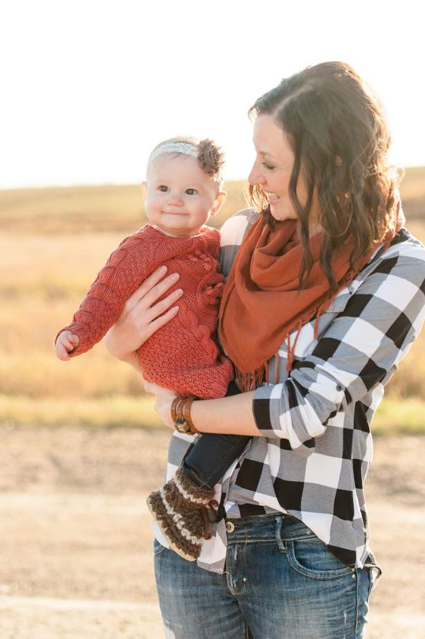 Little girl with her mother in plaid