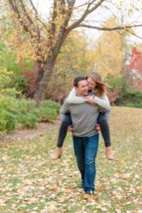 Man gives fiance a piggyback in their Regina engagement session