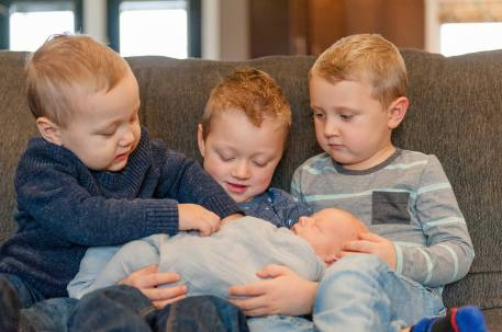 Older brothers with their new baby bro