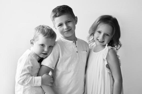 Three kids together in white