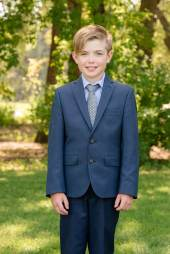 Tween in navy blue suit in Wascana Park