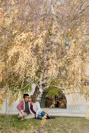 Couple under willow tree at the Regina Legislative Building