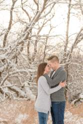 Man and woman stand together in the snow