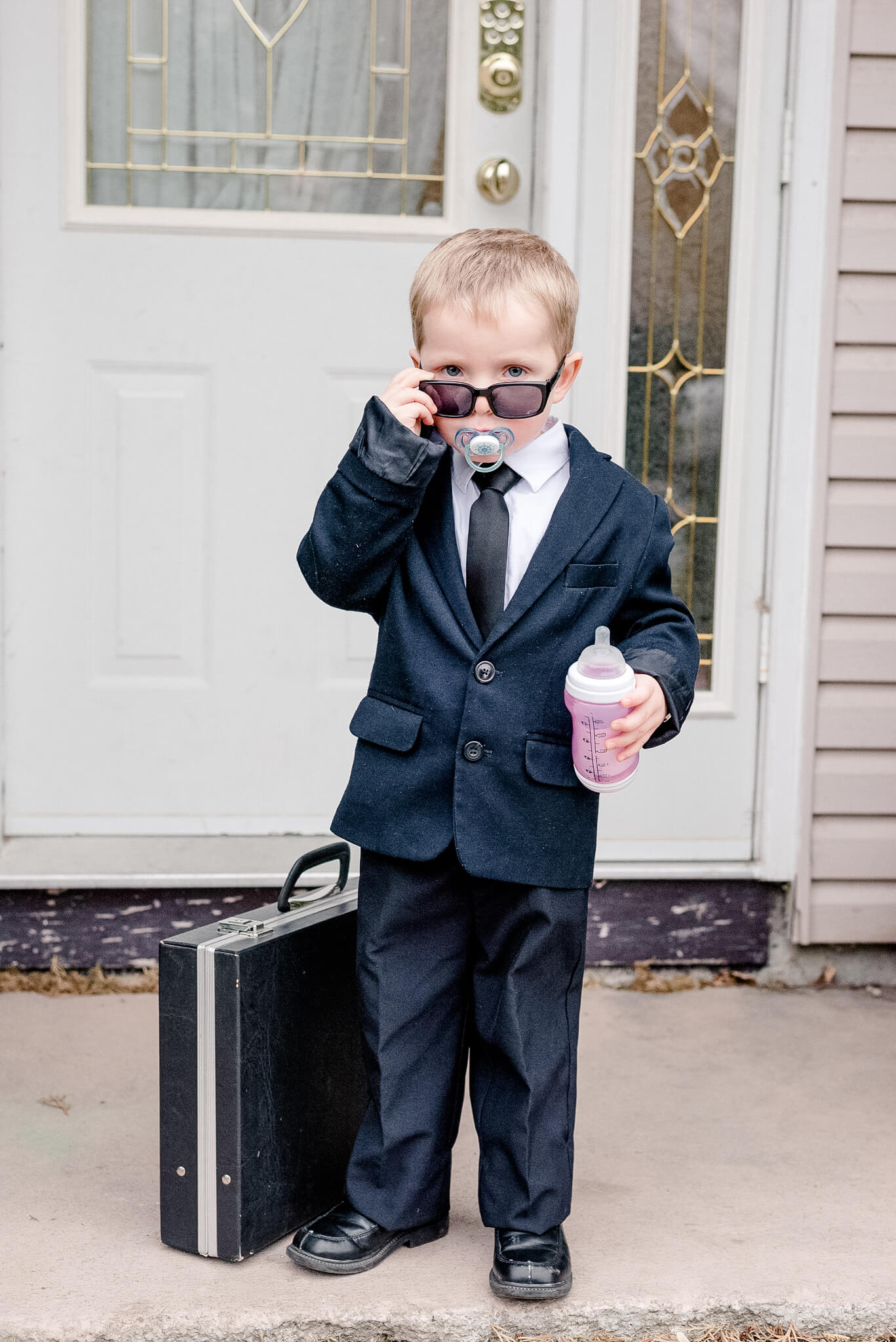Little boy dressed as Boss Baby