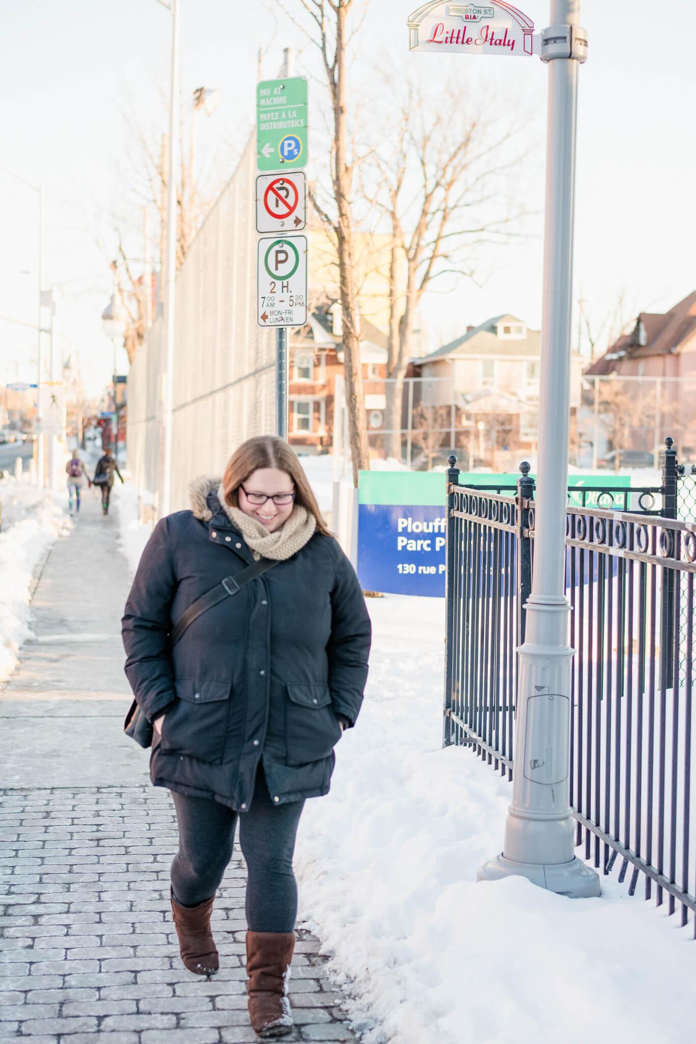 Woman walking down the street in winter