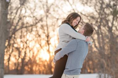 Cory lifting Kelsey in Regina engagement session