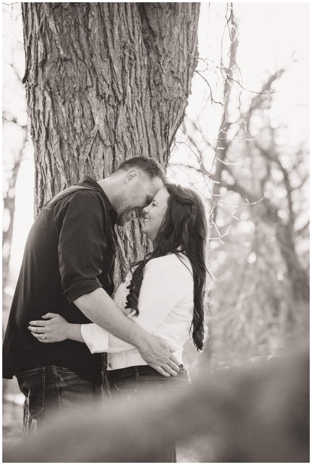 Travis & Coralynn Regina Engagement Session- Engaged couple nuzzling in Wascana Park