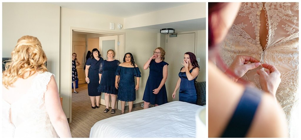 Regina Wedding Photographer - Nishant - Corrina - Bridal Prep - DoubleTree Regina - First Look with the Bridesmaids - Doing up the lace ivory button down gown
