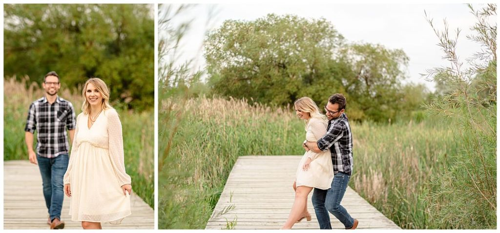 Regina Engagement Photography of Brett & Rachelle's Natural Light Engagement Session in Douglas Park in Regina. Man scoops up his bride-to-be on a dock in the Wascana Habitat Conservation Area