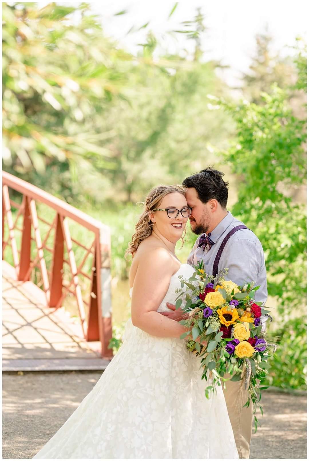 Regina Wedding Photographer - Ryan - Aeliesha - Bride & groom in front of the bridge of AE Wilson Park