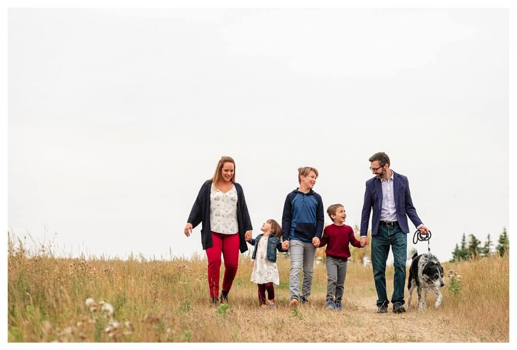 Schlamp Family 2020 - 001 - Regina Family Photographer - Family walking through the field