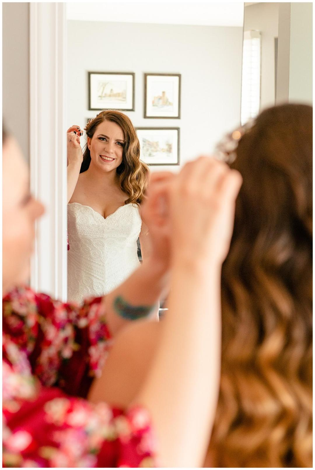 Regina Wedding Photographer - Tim & Jennelle At Home Wedding - Bride final touches with hair clip