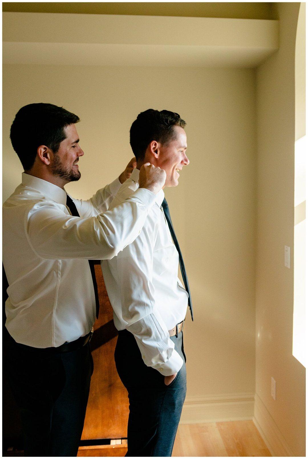 Regina Wedding Photographer - Tim & Jennelle At Home Wedding - Bestman helping with groom's collar