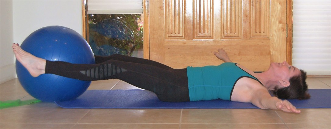 leg lift with exercise ball