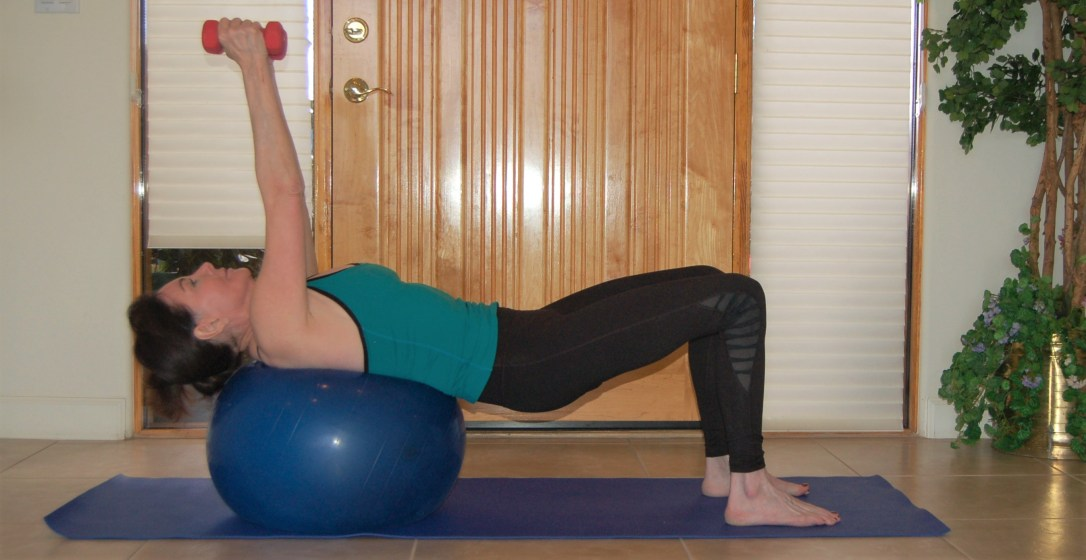 Dumbbell fly with exercise ball