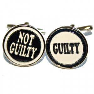 Cufflinks with the words Guilty and Not Guilty