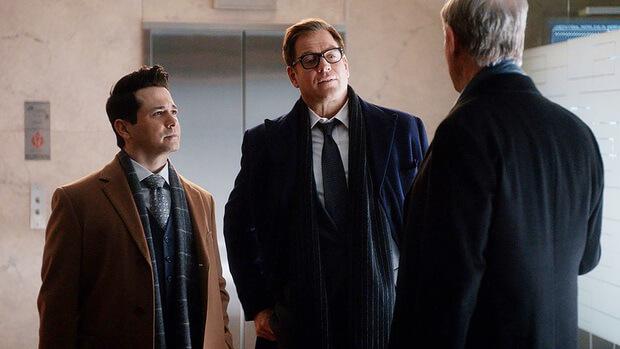 Scene of three men talking from Bull TV series