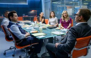 "characters from CBS drama ""Bull"" sitting at conference table"