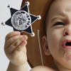 Photo of toddler with sheriff's star illustrating article by Richard Klass Esq. about New York City marshals.