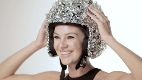 Candice Swanepoel with a crystal helmet
