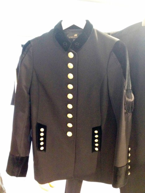 Single-breasted jacket with velvet embroidered collar and fringed sleeve