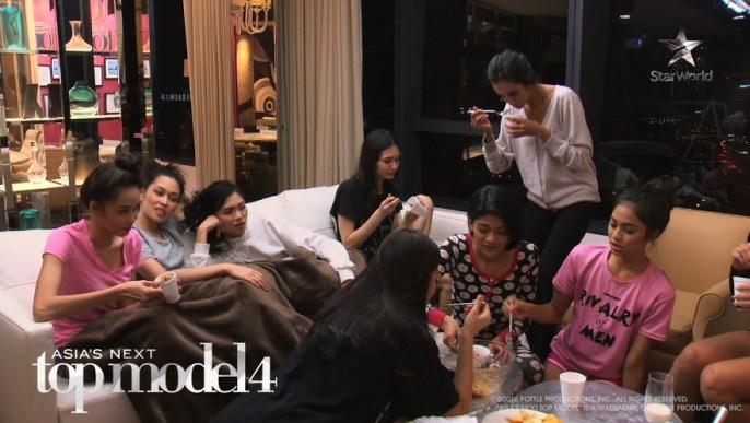 Girls eating in the model house