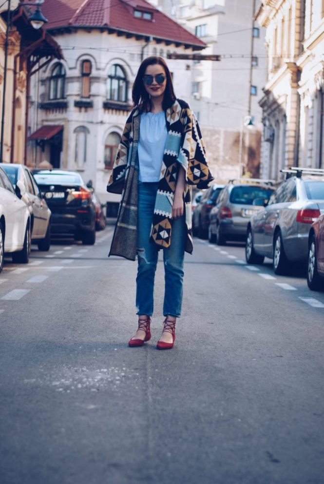 Red lace up flats and print cape by Andreea Birsan