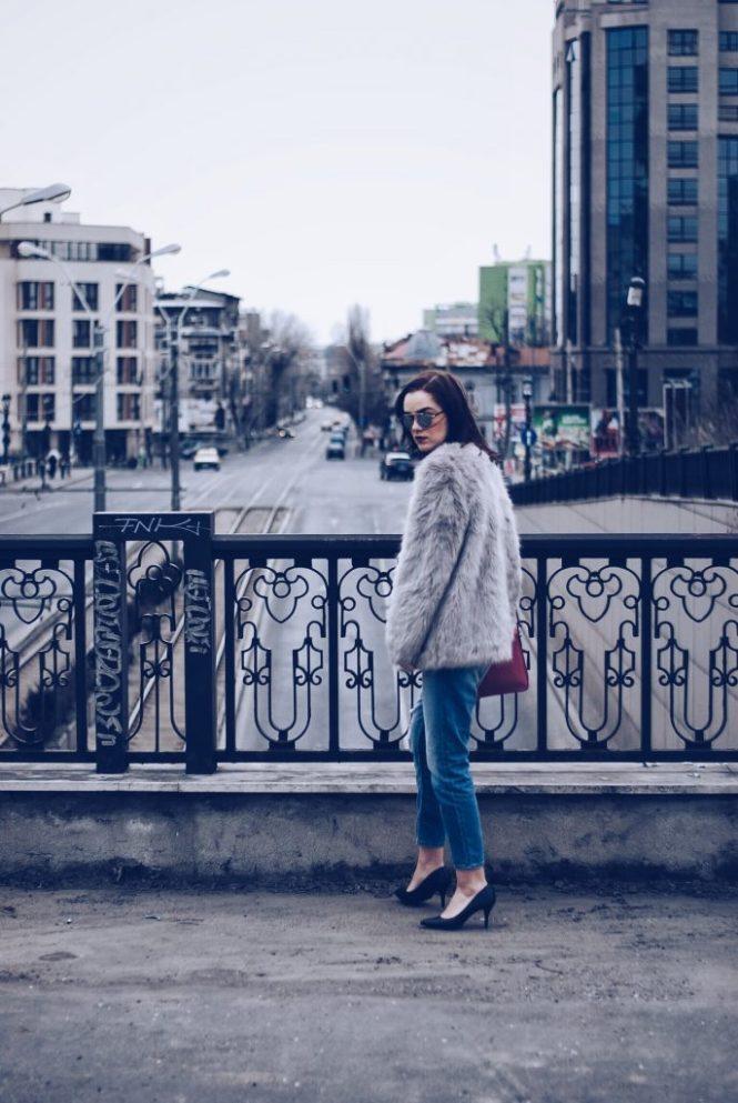 Faux fur, distressed boyfriend jeans, pumps, SoReal sunglasses by Andreea Birsan