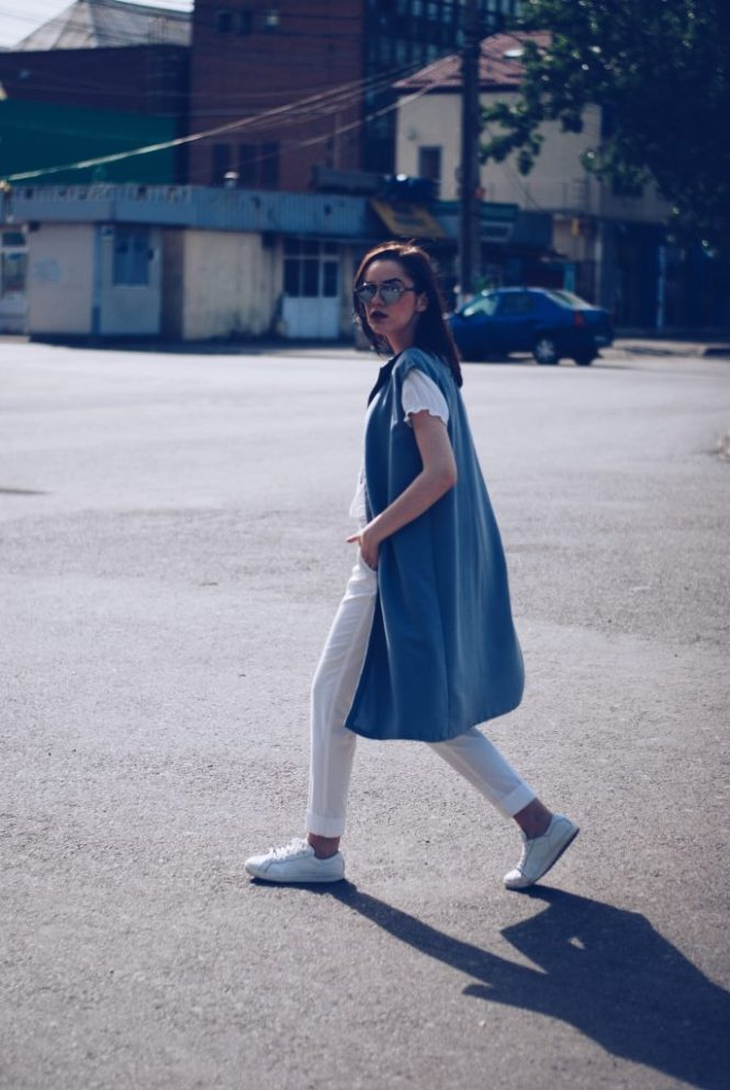White outfit, white embroidered shirt, white trousers, white sneakers, so real sunglasses, grey vest by Andreea Birsan