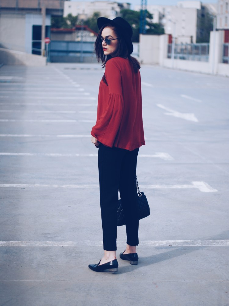 Bell sleeve blouse, black trousers, black hat, leather loafers, leather bag, so real sunglasses, spring outfit by Andreea Birsan