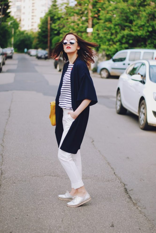 Striped tshirt, so real sunglasses, navy jacket, white trousers, yellow kelly bag, silver metallic shoes, spring outfit by Andreea Birsan