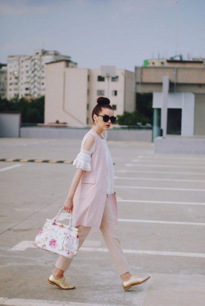 Pink trousers, lace cutout white blouse, black sunglasses, pink waistcoat vest, gold metallic oxford shoes, flower print bag, cute pink summer outfit, Andreea Birsan