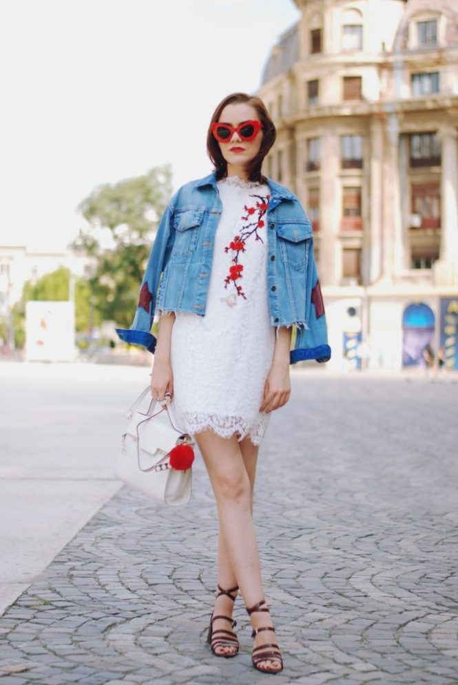 Embroidered white lace dress, red sunglasses, denim jacket, strappy sandals, white crossbody bag, red pom pom. cute summer outfit, Andreea Birsan